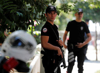 Police officers patrol outside the home of U.S. pastor Andrew Brunson in Izmir