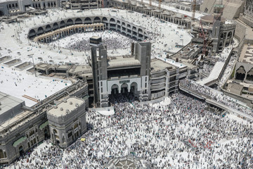 Muslim pilgrims walk out after the Friday prayer at the Grand mosque ahead of annual Haj pilgrimage in the holy city of Mecca,