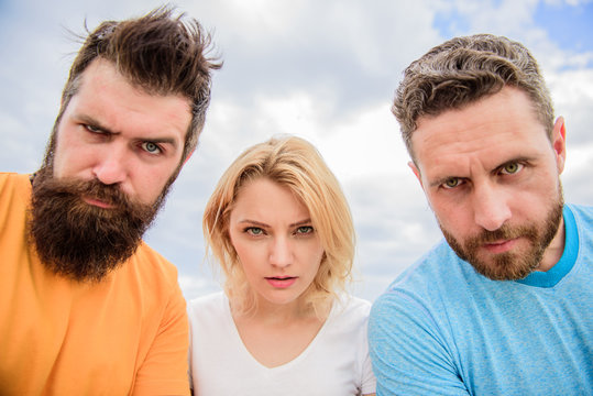 Group people suspect you. Suspicious look. Threesome suspiciously look down. Woman and men look confident sky background. Strength in unity. Stand up for their position. They know what you did