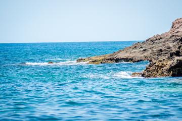Saaidia island and waves and rocks