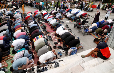 Worshippers attend Friday prayers outside a mosque in Istanbul