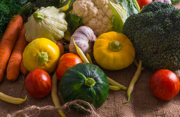 Different vegetables, small patissons, along with other vegetables, cauliflower, broccoli, garlic, cucumbers grown on an eco-farm