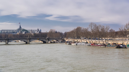 Paris, panorama of the Concorde bridge, the Grand-Palais in background, and houseboats on the Seine