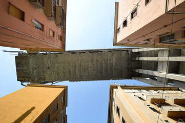 Section of the collapsed Morandi Bridge is seen above from the red zone in Genoa