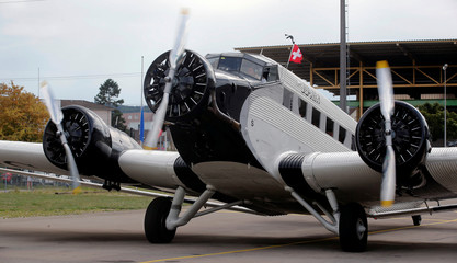 Chief pilot Pfisterer of JU-AIR airline starts the engines of a Junkers Ju-52 before starting from the airport in Duebendorf