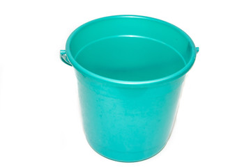 A bucket on a white background. Plastic green bucket on a white background. Bucket for washing floors.