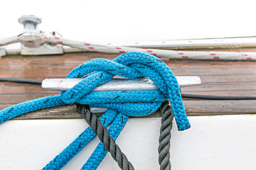 Yacht cleat and a tied rope