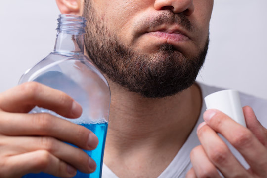 Man Rinsing His Mouth With Mouthwash