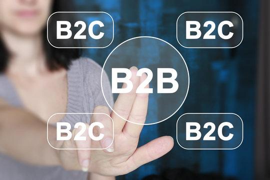 Businessman presses button b2b not b2c on virtual electronic user interface.