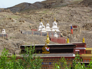 White stupas with golden tops and part of the the buddhist Sakya Monastery, Tibet