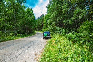 Car on a forest road. Chingisy, Novosibirsk oblast, Russia