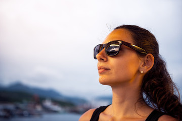 portrait of a young smiling girl in sunglasses with reflective glasses.