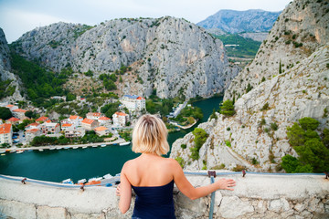 woman looking at the small town Omis