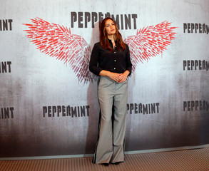 """Cast member Garner poses at a photo call for the movie """"Peppermint"""" in Los Angeles"""