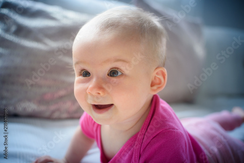 28dfe3d00779 Sweet adorable baby girl lying on a couch looking towards camera. 6 ...