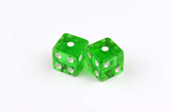 A pair of green, translucent gaming dice showing snake eyes