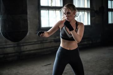 Female Boxer preparing for training in Boxing Club