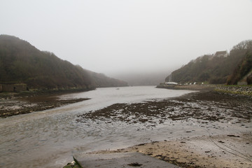 Bay in evening mist. Mouth of the River Solva