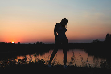 silhouette of a girl at sunset