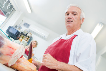 Upward view of butcher holding knife