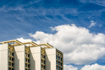 Multi Storey Building Facade and Cloudy Blue Sky. Minimalistic Fine Art Photography of Modern Architecture.