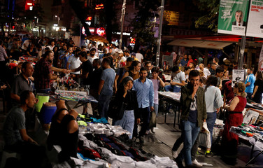 Street vendors sell goods on a main street in central Ankara