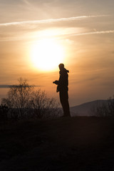 Silhouette of human during sunset. Autumn nature.