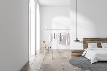 White bedroom interior, clothes rack