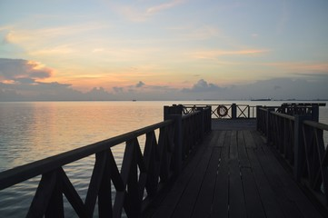 a jetty during sunrise