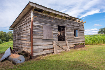 A beautiful old storage shed for farm tools and equipment by a corn field in rural, upstate South Carolina.