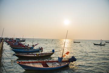 fishing boats pier at sea