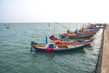 fishing boats pier at sea