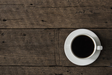 coffee cup on the old wooden floor