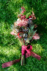 A bouquet on the grass.