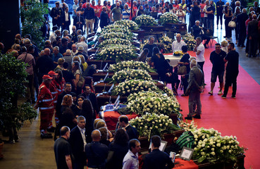 People gather to attend the state funeral of the victims of the Morandi Bridge collapse, at the Genoa Trade Fair and Exhibition Centre in Genoa