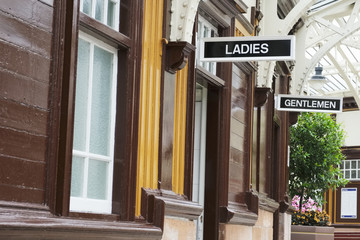 Victorian ladies and gents toilets Art Deco style white and black sign