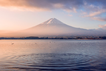 Volcano mount Fuji colorful sunrise with ripple wave Wall mural