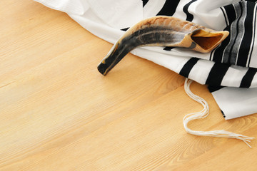 shofar (horn) on white prayer talit. rosh hashanah (jewish holiday) concept. Rosh hashanah (jewish New Year holiday), Shabbat and Yom kippur concept.