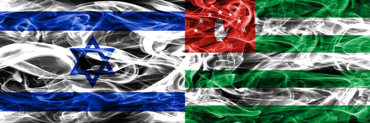 Israel vs Abkhazia smoke flags placed side by side. Israeli and Abkhazia flag together