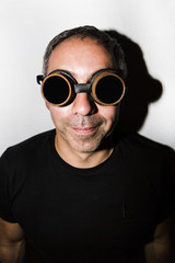 Man in steampunk glasseses on white background