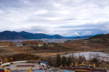 Landscape view of Songzanlin monastery temple, temple of Buddhism in Shangri-la, China, golden traditional temple landmark and famous place for travel