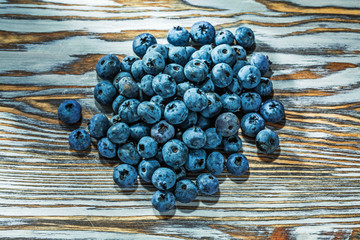 Heap of blueberries on wooden board