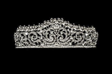 silver diadem with diamonds isolated on black