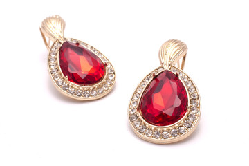 Wall Mural - gold earrings with ruby drops isolated on white