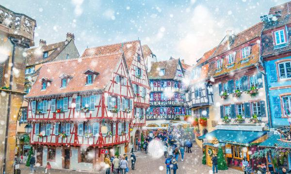 Christmas market under the snow in France, in Colmar near Strasbourg, Alsace