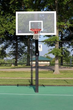 The basketball hoop on the outdoor basketball court.