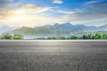 Poster Grijs Empty asphalt highway and green mountain nature landscape at sunset