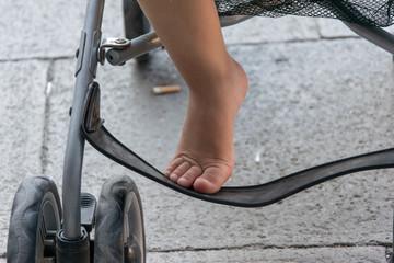 Little girl's foot resting on the stroller