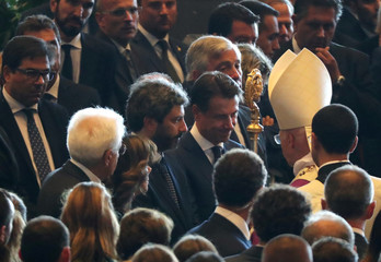 Italian Prime Minister Giuseppe Conte and Archbishop of Genoa, Cardinal Angelo Bagnasco, are seen at the end of the state funeral of the victims of the Morandi Bridge collapse, at the Genoa Trade Fair and Exhibition Centre in Genoa
