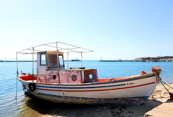 Old, abandoned fishing boat at Michaniona port. Thessaloniki, Greece